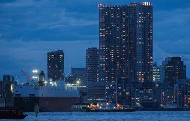 TOKYO, JAPAN - AUGUST 15TH, 2018. Huge cruise ship at Tokyo's waterfront at dusk.