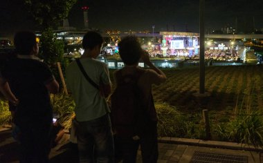 TOKYO, JAPAN - AUGUST 15TH, 2018. People watching a show from afar in Odaiba.