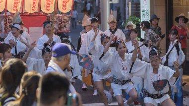 TOKYO, JAPAN - AUGUST 19TH, 2018. Dancers wearing traditional clothing performing in the street during Awa Odori festival in Shimokitazawa.