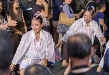 TOKYO, JAPAN - AUGUST 19TH, 2018. Dancers wearing traditional clothing performing in the street during Awa Odori festival in Shimokitazawa.