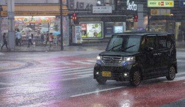 TOKYO, JAPAN - JULY 29TH, 2018. Vehicle on the street of Shibuya during a rainy typhoon season.