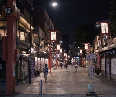 TOKYO, JAPAN - AUGUST 3RD, 2018. Tourist ecploring the Asakusa street  at night.