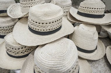 pile of straw hats as a background