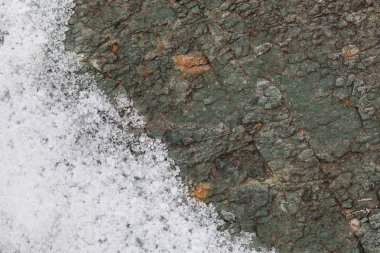 Stone surface covered with hoarfrost, abstract winter background