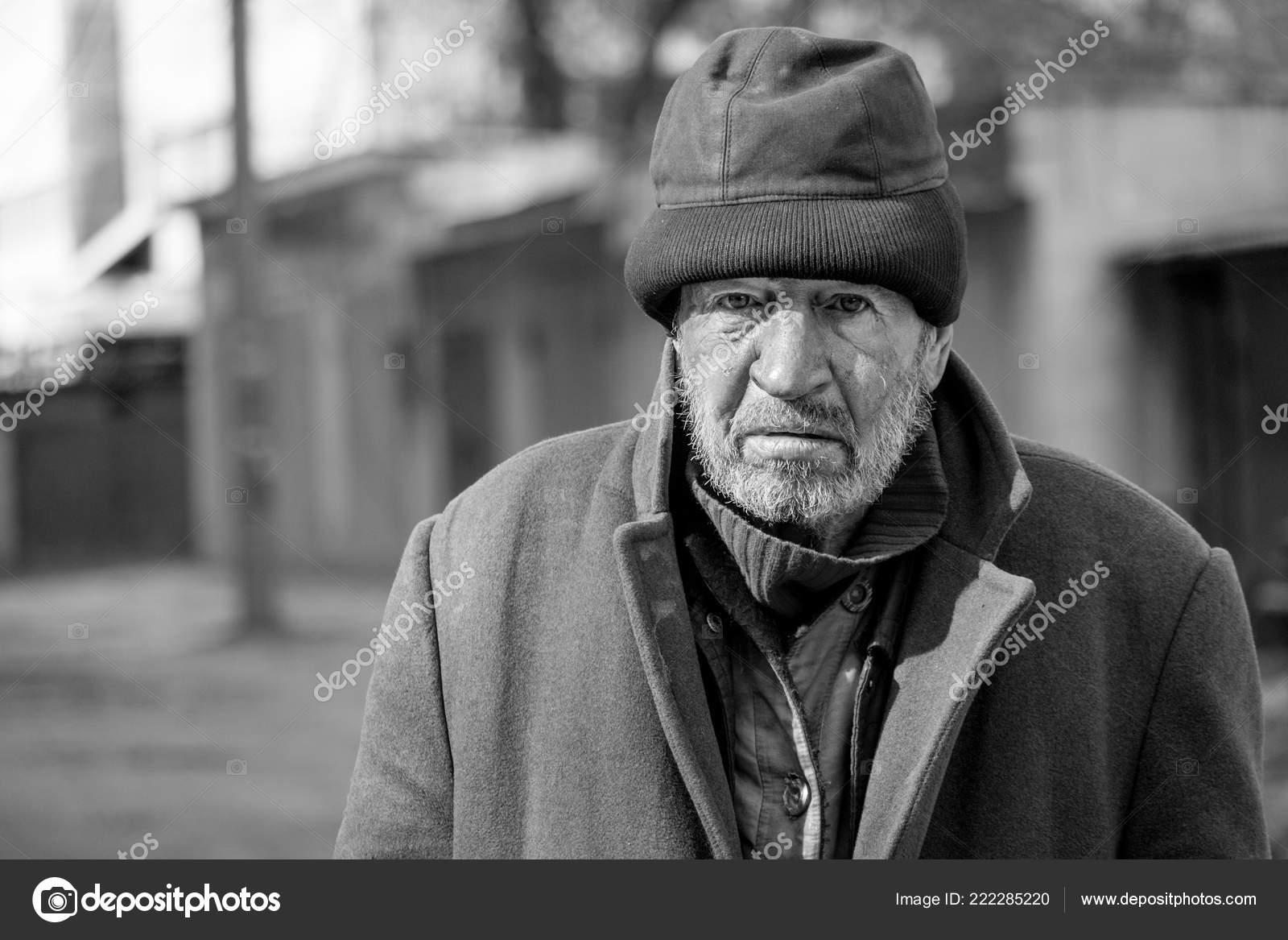 Black white tramp photo homeless hungry man stock editorial photo