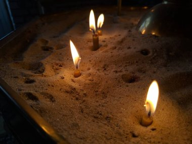 burning candlescandles are burning in the sand