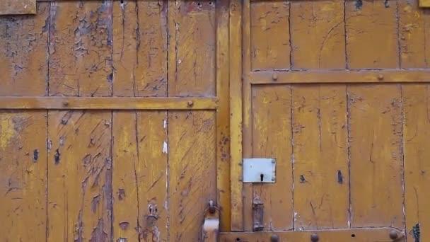 yellow wooden gate. vintage wooden gate