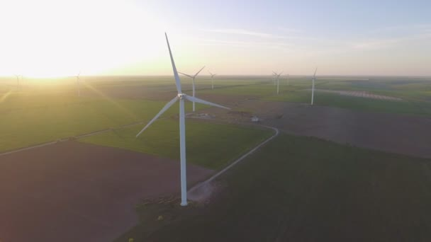 Wind turbines and agricultural fields - Energy Production with clean and Renewable Energy - aerial shot