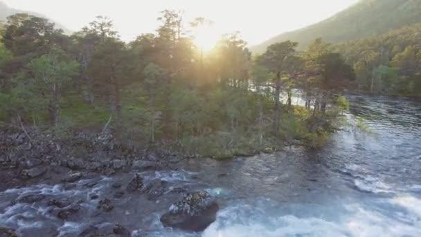 Aerial view of Rapid Stunning Waterfall in Husedalen Valley, Norway. Summer time.