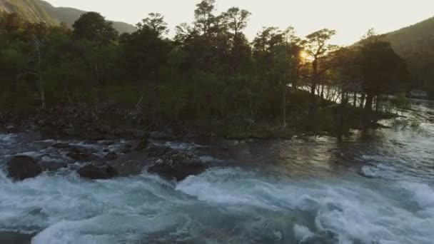 Aerial view of river in Husedalen Valley, Norway. Summer time. Sunset