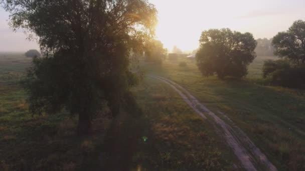 foggy road. River valley bent early morning fog clouds. yellow orange sunrise horizon. Aerial drone beautiful Ukraine nature landscape. Romantic cinematic mood