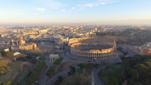 Flying over Colosseum, Rome, Italy. Aerial view of the Roman Coliseum on sunrise.