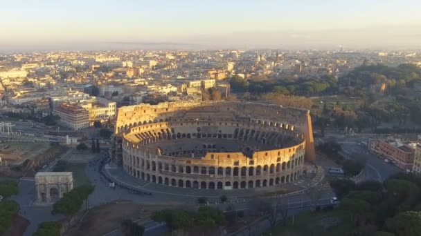 Flying over Colosseum, Rome, Italy. Aerial view of the Roman Coliseum on sunrise. Beautiful view of the famous Italian landmark, travel icon