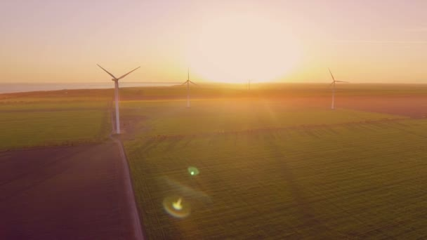 Aerial Flying Over Renewable Energy Wind Farm Wind Turbines. Sunset