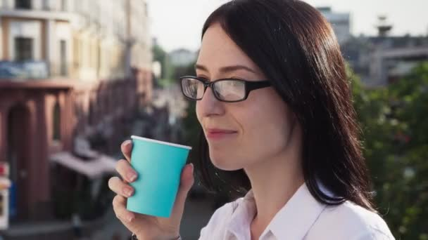 Successful businesswoman looking into distance, drinking coffee and enjoying