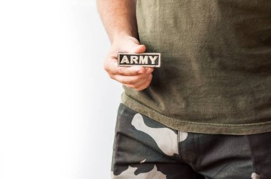 Man holding patch with word army stock vector