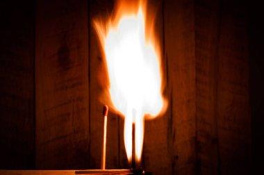 burning match on wooden background