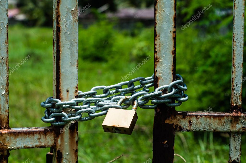 metal gate locked by chain and padlock