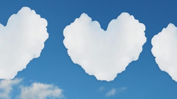 Hearts of clouds fly against the blue sky. Symbol of love. Video.
