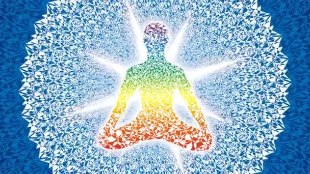 Silhouette of a yogi in a lotus asana on the light blue background of a rotating mandala