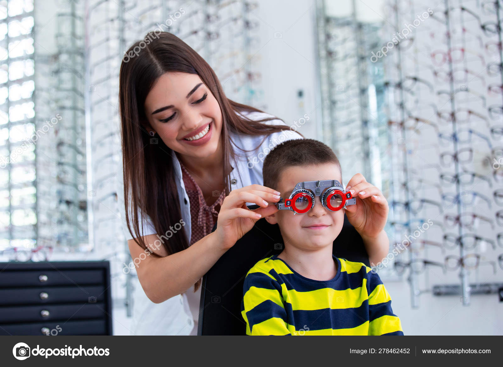Attractive Ophthalmologist Examining Youg Boy With Optometrist Trial Frame Kid Patient To Check Vision In Ophthalmological Clinic Stock Photo C Royalty 278462452 Used after someone's name to show…. https depositphotos com 278462452 stock photo attractive ophthalmologist examining youg boy html