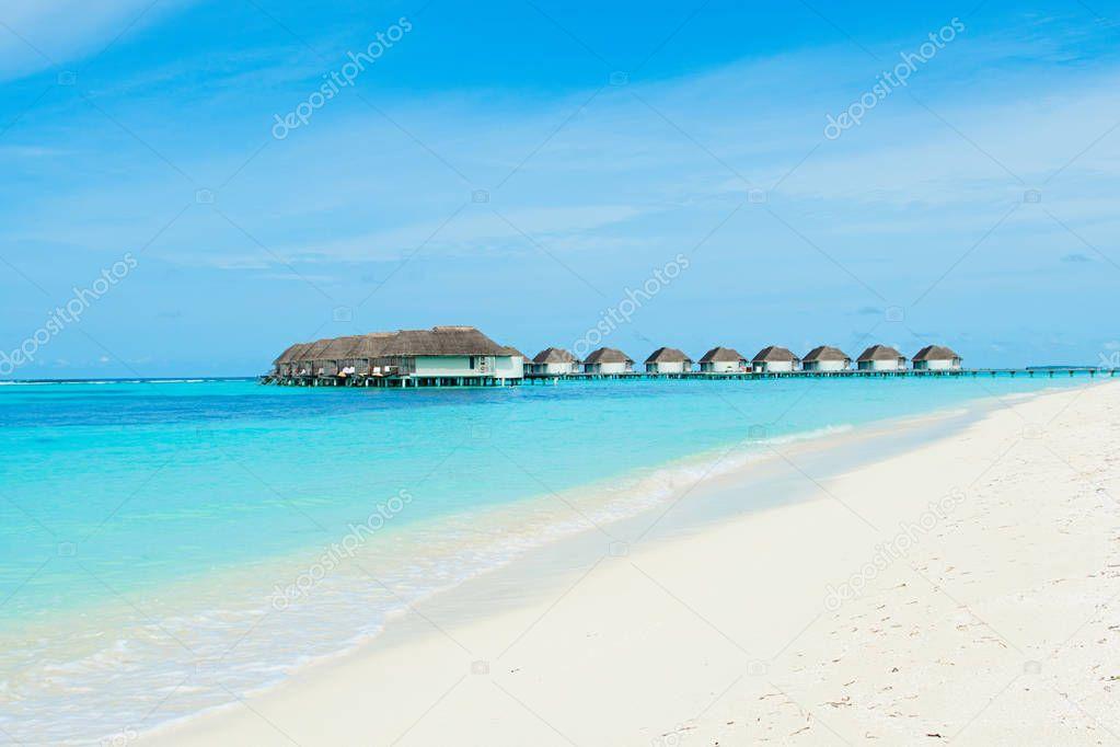 Lhaviyani Atoll, Maldives - 12 July 2018: Beautiful landscape of over water villas in luxury hotel, Kanuhura island