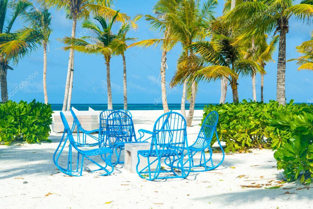 Chill lounge zone with a tent and seating areas in luxury hotel on the shore of Indian Ocean, Maldives