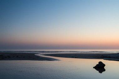Stunning colorful vibrant sunrise over low tide beach landscape peaceful scene stock vector