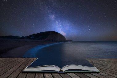 Vibrant Milky Way composite image over landscape of long exposur