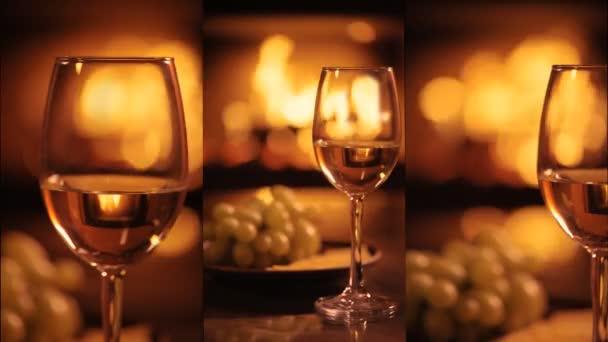 Vertikale Videos von einem Weißweinglas über dem Kamin Hintergrund. Zeitlupe.