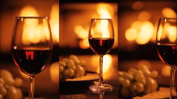 Vertikální videa jedné červené víno pohárky nad krb pozadí. Zpomalený pohyb.