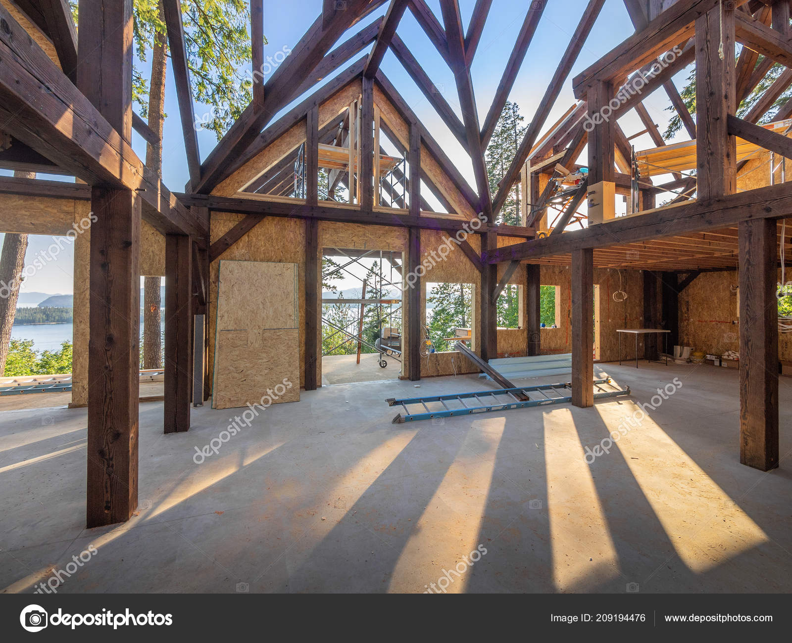 New house interior post beam construction stock photo