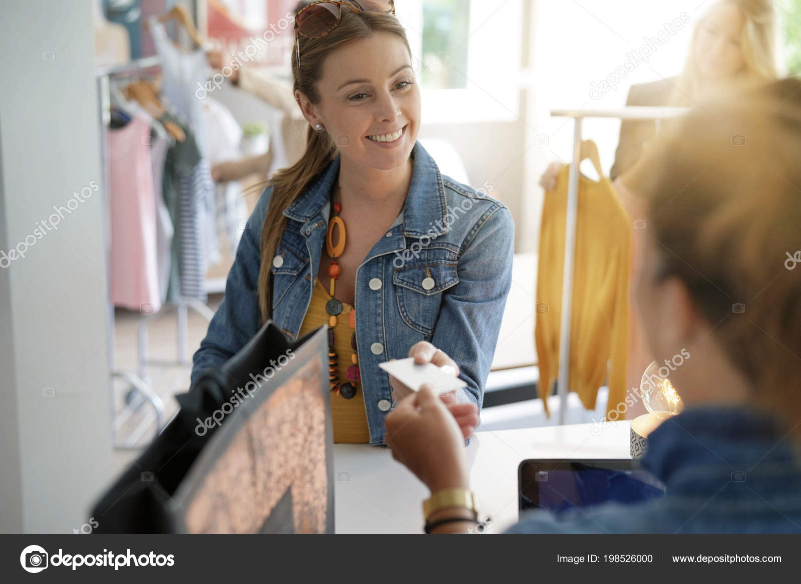 Woman Clothing Store Paying Credit Card Stock Photo C Goodluz