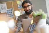 Start-up entrepreneur working on laptop