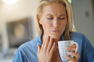 40-year-old woman having sore throat