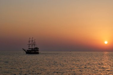 vintage boat in the sea. sunset