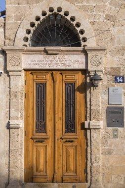 Tel Aviv, Israel - June 10, 2018: Building exteriors and streets in Neve Tzedek district of Tel Aviv, Israel. Near the old city of Jaffa, Neve Tzedek is the first Jewish settlement in Palestine.