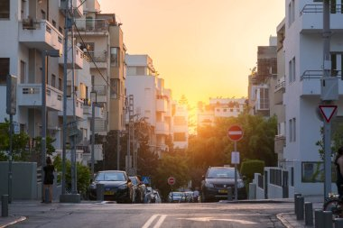 Tel Aviv-Yafo, Israel - June 9, 2018: Urban view from the famous Rothschild Boulevard in Tel Aviv. The Boulevard is a popular central meeting point for locals and visitors.