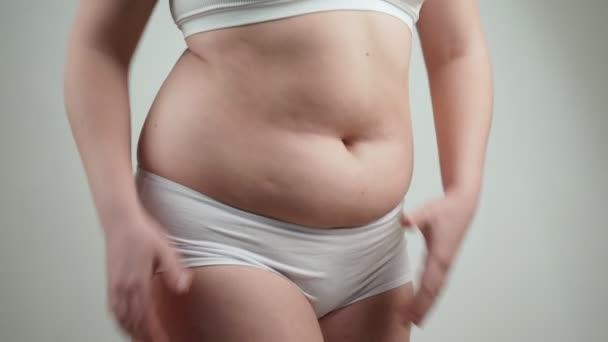 cute latest collection choose genuine Woman in white underwear holds her belly fat.