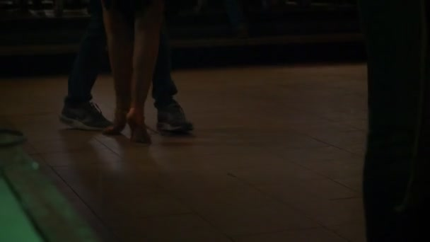 Couples dancing kizomba in the club.