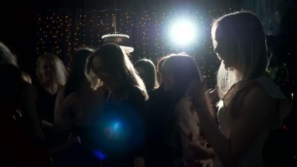 Young women having fun on hen-party.