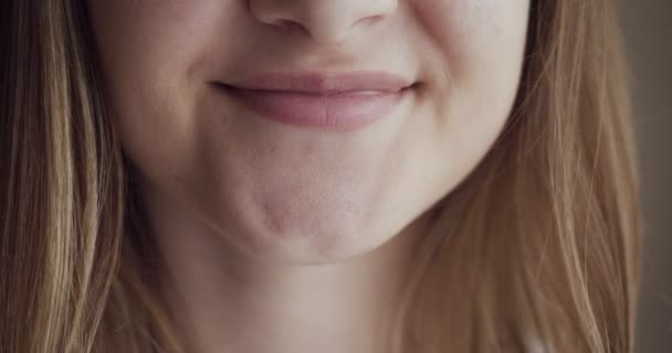 Close-up woman mouth smiling with beautiful soft lips.