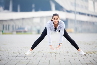 Woman Stretching Body, Doing Exercises On Street