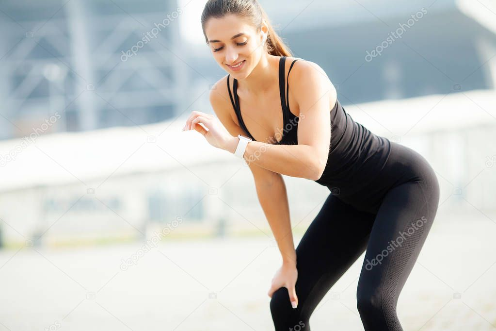 Sport outdoor. Young fitness girl doing squats outdoors in summer