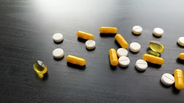 Medical Pills. Colored Pills And Capsule On Black Table. Pharmacy Theme, Capsule Pills With Medicine Antibiotic in Packages