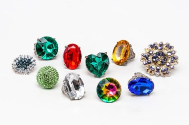 Color crystal fashion rings on white background.