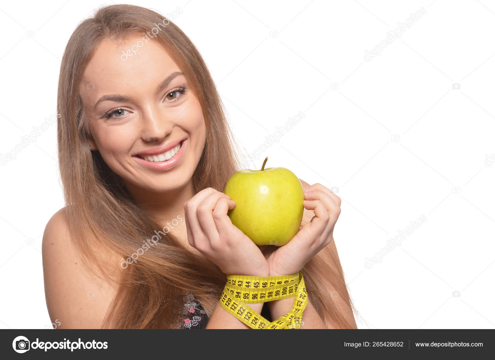 Portrait Of A Cute Girl With Red Grapes Stock Photo