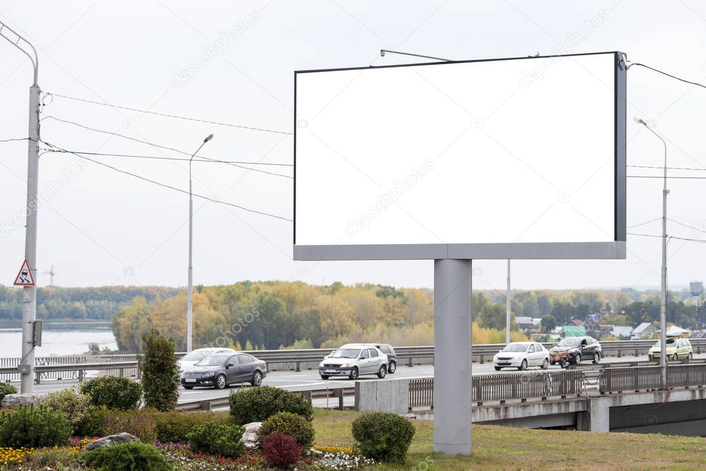 Blank large Billboard next to the bridge where the cars are moving