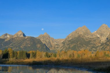a beautiful scenic landscape of the Tetons in autumn