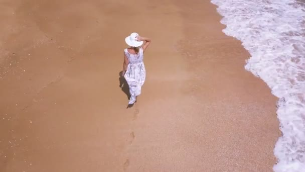 4K  Aerial. Slender woman and ocean or sea beach . Fly around